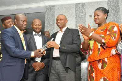 His Execellency Gov. Mimiko receiving his award of excellence